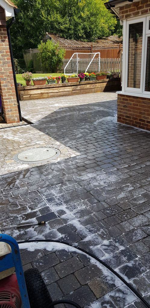 Driveway cleaned and treatment applied in Burgess Hill