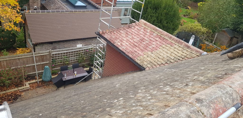 Roof cleaning and treated with an antifungal moss wash